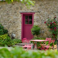 enjoy a glass of wine on the terrace of Rose cottage